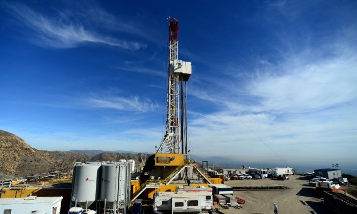 Crews work on stopping a gas leak at a relief well at the Aliso Canyon facility above the Porter Ranch area of Los Angeles on Dec. 9, 2015. The utility says it has stopped the natural gas leak near Los Angeles after nearly 4 months. (Dean Musgrove/Los Angeles Daily News via AP, Pool, File)