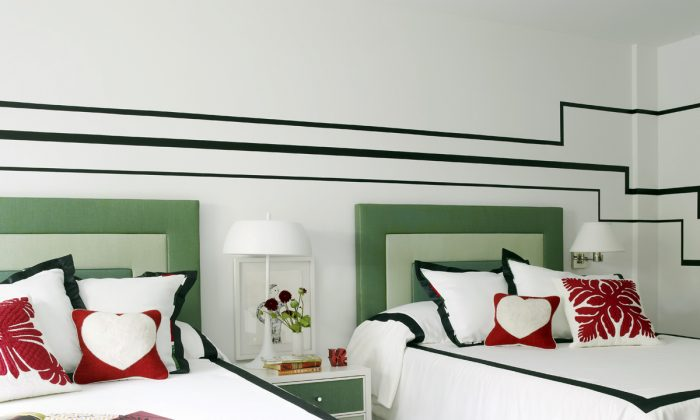 Upholstered headboards like the ones shown in this bedroom designed by Huh offer cheerful color and softness, while also absorbing sound. The quieter the bedroom, says designer Maxwell Ryan, the more welcoming and cozy the space will feel. (Ngoc Minh Ngo/Young Huh via AP)