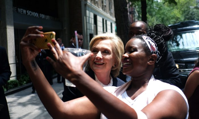 Democratic presidential hopeful Hillary Clinton takes a selfie with a student outside the New School in New York on July 13, 2015. (JEWEL SAMAD/AFP/Getty Images)