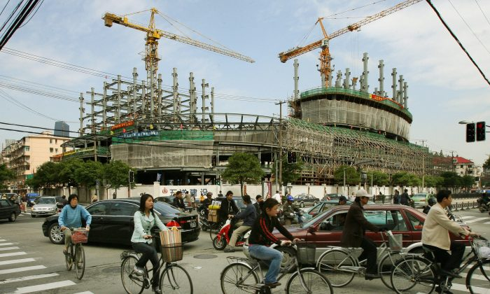 Traffic passes a property development under construction in Shanghai in a file photo. China's construction and services sectors are still awaiting rollout of value-added tax. (Mark Ralston/AFP/Getty Images)