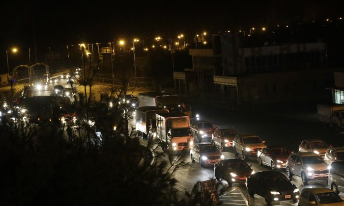 South Korean vehicles returning from North Korea's joint Kaesong Industrial Complex pass the customs, immigration and quarantine office near the border village of Panmunjom, in Paju, South Korea, Thursday, Feb. 11, 2016.  (AP Photo/Ahn Young-joon)