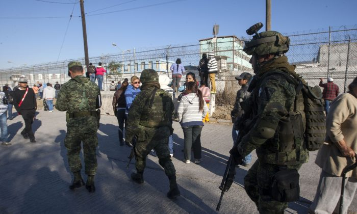 Soldiers walk outside the Topo Chico prison in the northern city of Monterrey in Mexico where according to Nuevo Leon State governor at least 52 people died and 12 were injured in a prison riot on February 11, 2016. (Julio Cesar Aguilar/AFP/Getty Images)
