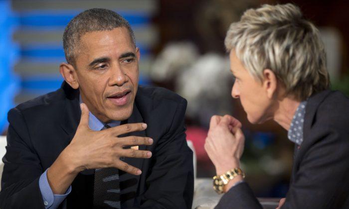 President Barack Obama talks with Ellen DeGeneres during a commercial break while taping a show segment of the Ellen DeGeneres Show in Burbank, Calif., Thursday, Feb. 11, 2016. (AP Photo/Pablo Martinez Monsivais)