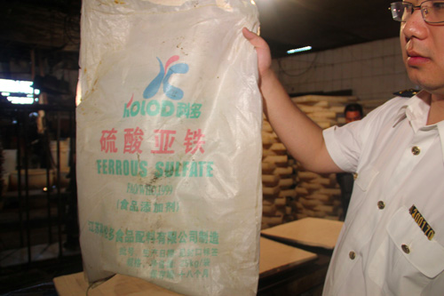 Guobiao Stinky Tofu's factory included a large bag of ferrous sulfate used to dye the tofu black. (via China Quality News)