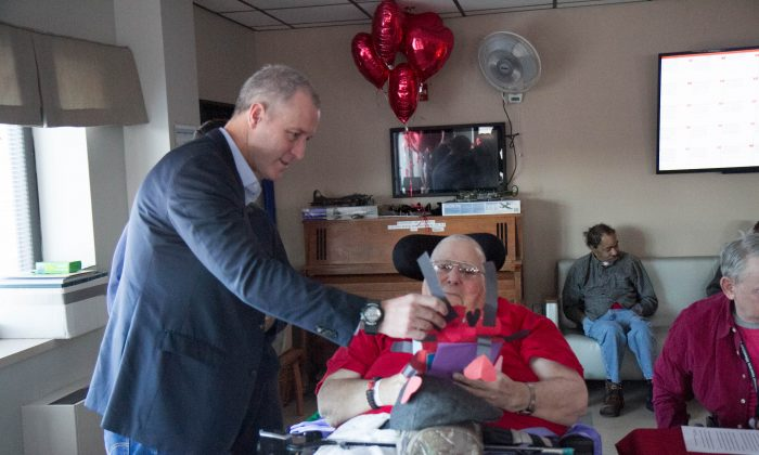 U.S. Rep. Sean Patrick Maloney hands a veteran a Valentines Day card on Feb. 13, 2016 at Castle Point in Wappingers Falls. (Holly Kellum/Epoch Times)