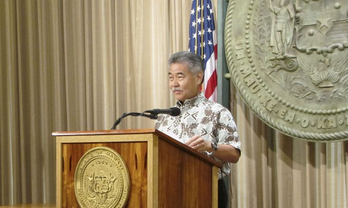Hawaii Gov. David Ige talks with reporters at the capitol in Honolulu on Feb. 26, 2015. (AP Photo/Cathy Bussewitz)