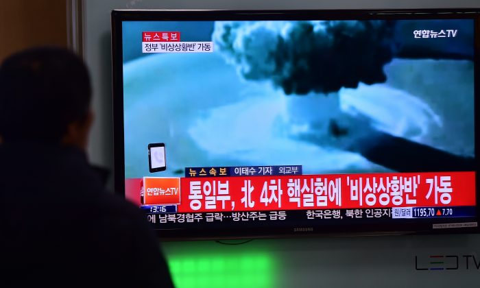 People watch a news report on North Korea's first hydrogen bomb test at a railroad station in Seoul on Jan. 6, 2016. (Jung Yeon-je/AFP/Getty Images)