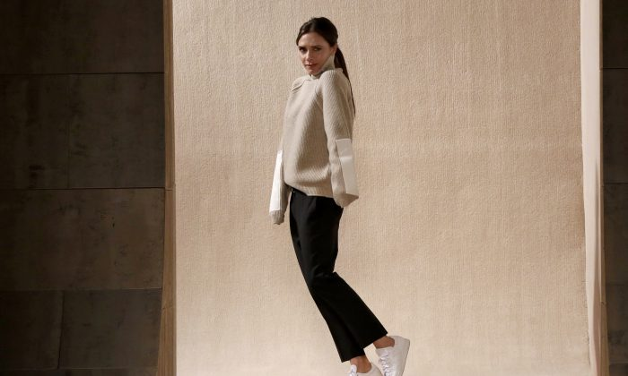 Victoria Beckham appears on the runway after her Fall 2016 collection was modeled during Fashion Week in New York, Sunday, Feb. 14, 2016. (AP Photo/Richard Drew)