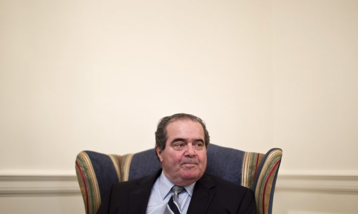 Supreme Court Justice Antonin Scalia is interviewed by The Associated Press, on July 26, 2012, at the Supreme Court in Washington. (AP Photo/Haraz N. Ghanbari)
