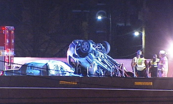 In this image made from video, emergency workers stand at the scene of a fatal collision on Interstate 75 in Dayton, Ohio, early Saturday, Feb. 13, 2016. A suspected drunken driver going the wrong way slammed head-on into an SUV, killing himself and four people inside the other vehicle, police said. (WHIO-TV Dayton via AP)