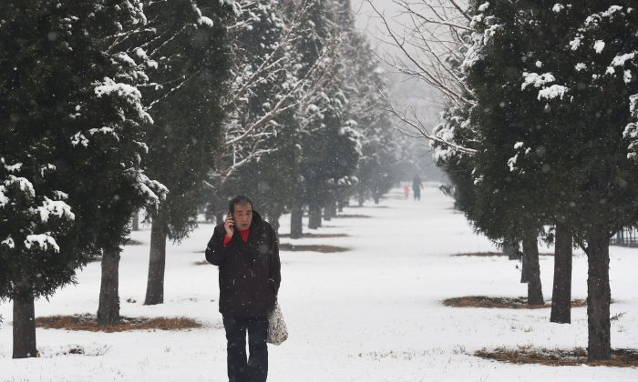 Snow in China didn't make it cold enough to turn on heaters in Shandong. (Greg Baker/AFP/Getty Images)