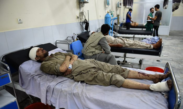 Injured Afghan men receives treatment at Wazir Akbar Khan hospital after a suicide truck bomb explosion in Kabul on August 7, 2015.  A powerful truck bomb killed at least seven people and wounded dozens of others, officials said, the first major attack in the Afghan capital since the announcement of Taliban leader Mullah Omar's death.     (Wakil Kohsar/AFP/Getty Images)