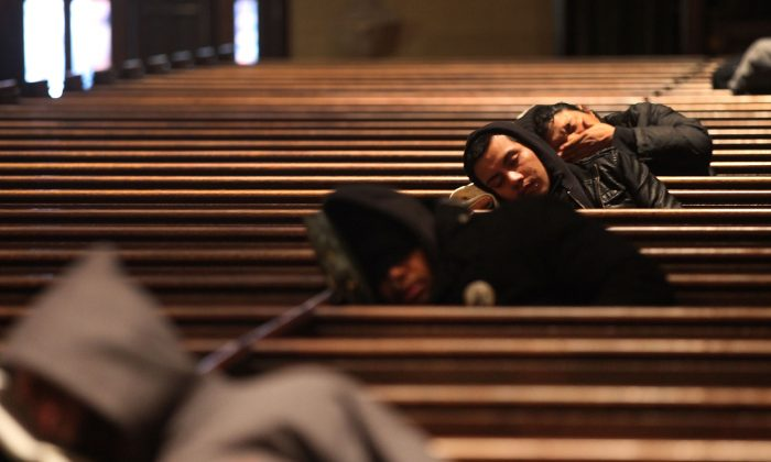 Homeless people find warmth at St. Mary the Virgin Church in Manhattan on a bitterly cold day in New York City on Feb. 13, 2015. (Spencer Platt/Getty Images)