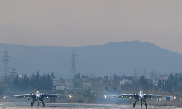 Two Russian Sukhoi Su-24 bombers at the Russian Hmeimim military base in Latakia Province, in the northwest of Syria, on Dec. 16, 2015. (Paul Gypteau/AFP/Getty Images)