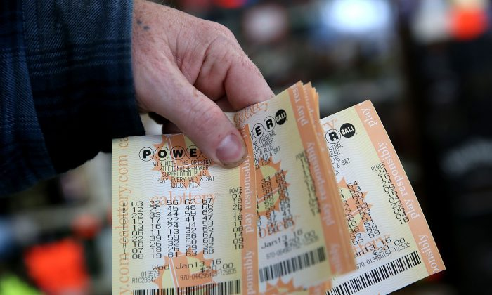 A customer holds a handful of Powerball tickets at Kavanagh Liquors on January 13, 2016 in San Lorenzo, California. ( Justin Sullivan/Getty Images)