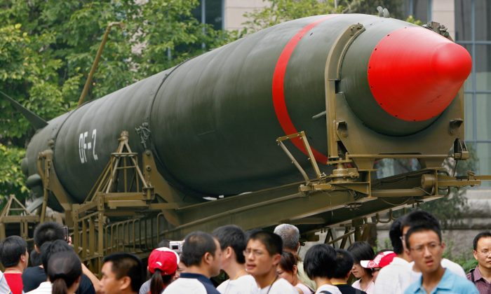 Visitors walk past China's second nuclear missile on display as they visit the Military Museum in Beijing, 23 July 2007.  (TEH ENG KOON/AFP/Getty Images)