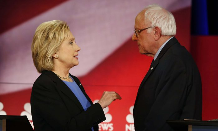 Democratic presidential candidates Hillary Clinton and Sen. Bernie Sanders (I-Vt.) during a break at the NBC-YouTube Democratic presidential debate at the Gaillard Center in Charleston, S.C., on Jan. 17, 2016. (AP Photo/Mic Smith)