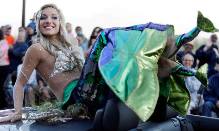 In this Sept. 14, 2013 file photo Miss New Jersey Cara McCollum displays her shoes during the Miss America Shoe Parade at the Atlantic City, N.J. boardwalk. McCollum was critically injured when her convertible spun off a highway and hit a tree, state police said Tuesday. (AP Photo/Julio Cortez, File)