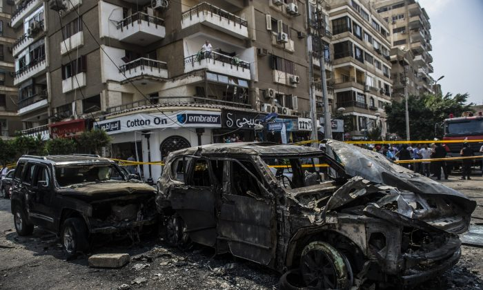 Burnt-out vehicles are seen at the site of a bomb attack that targeted the convoy of the Egyptian State Prosecutor Hisham Barakat, who died hours after the powerful explosion hit his convoy, in Cairo, Egypt, on June 29, 2015. The bombing came after the Islamic State's affiliate in Egypt called for attacks on the judiciary following the hanging of six alleged militants. (Khaled Desouki/AFP/Getty Images)
