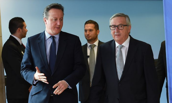 British Prime Minister David Cameron (L) is welcomed by European Commission President Jean-Claude Juncker prior to their meeting at the European Commission in Brussels, on Feb. 16, 2016.  (EMMANUEL DUNAND/AFP/Getty Images)