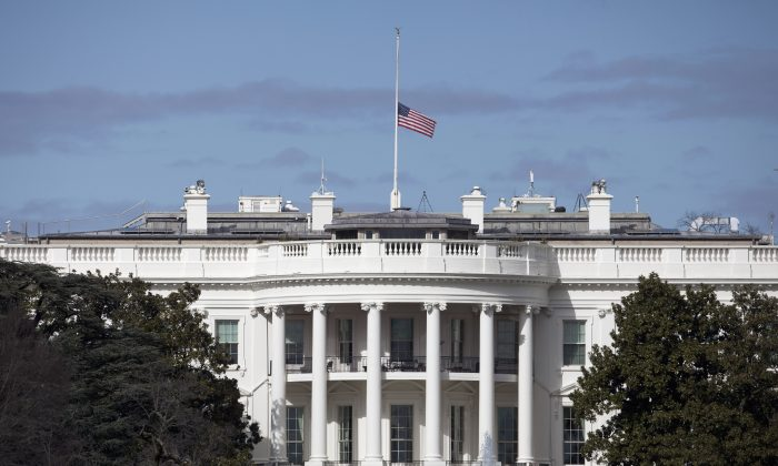 The flag flies at half-staff atop the White House in Washington, D.C., on Feb. 16, 2016. (AP Photo/Carolyn Kaster)