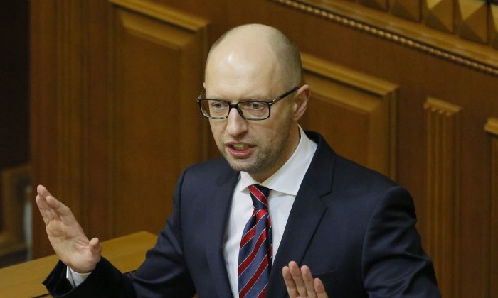 Ukrainian Prime Minister Arseniy Yatsenyuk during an annual report in Parliament in Kyiv, Ukraine, on Feb. 16, 2016. (AP Photo/Sergei Chuzavkov)