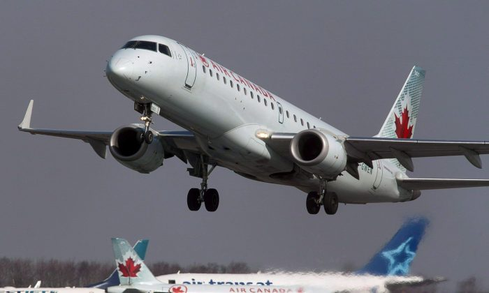 Air Canada says carriers should be allowed to share information about unruly passengers to help keep the skies safer. (The Canadian Press/Andrew Vaughan)