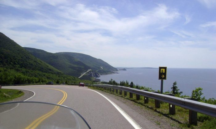 The road along the Cabot Trail in Cape Breton, Nova Scotia. A Cape Breton man who put together a website encouraging Americans to move to Cape Breton if Donald Trump is elected is receiving lots of enquiries about the island. (THE CANADIAN PRESS/AP-Glenn Adams)