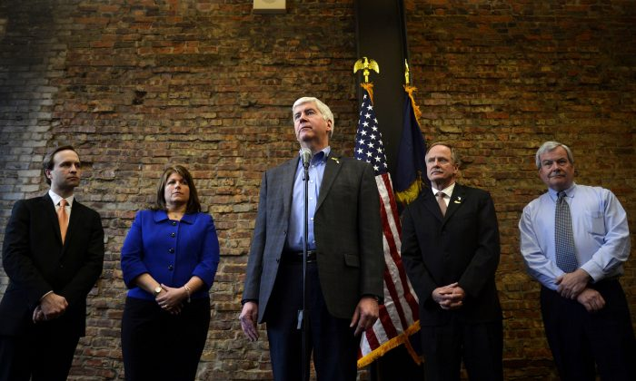 Gov. Rick Snyder at a press conference at Rowe Professional Services in Flint, Mich., on Feb. 17, 2016. Snyder announced next steps to identify and replace high-risk, high-priority pipes in Flint. Rowe Professional Services will be conducting tests to determine where replacement pipes should be installed. Flint is under a state of emergency because corrosive water was allowed to leach lead from pipes into the supply. (Rachel Woolf/The Flint Journal-MLive.com via AP)