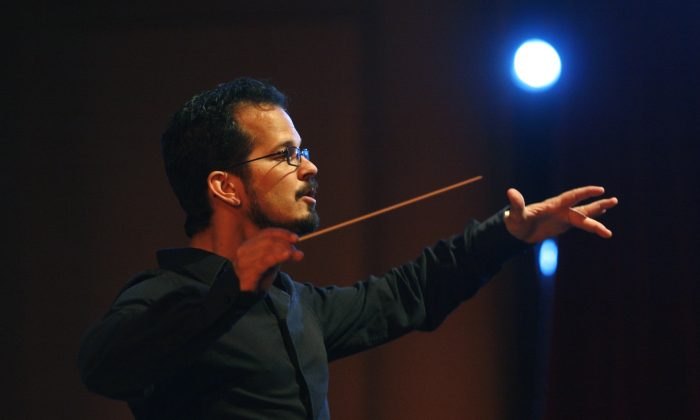 "Conductor Mark Sforzini rehearses ""Carmen'' with the St. Petersburg Opera Company at the Palladium  on May 28, 2010 in St. Petersburg, Fla. (Lara Cerri/The Tampa Bay Times via AP)"