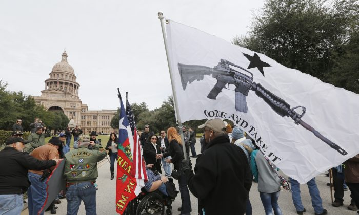 On January 1, 2016, the open carry law took effect in Texas, and 2nd Amendment activists held an open carry rally at the Texas state capitol on January 1, 2016 in Austin, Texas. (Erich Schlegel/Getty Images)