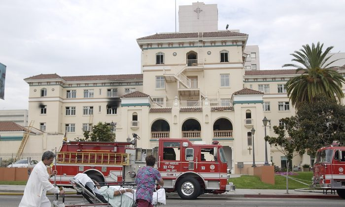 Nurses evacuate a patient after a fire at the Hollywood Presbyterian Medical Center on July 22, 2003. The FBI said on Feb. 17, 2016, it is investigating a computer network extortion plot at the Los Angeles hospital. (AP Photo/Nick Ut)