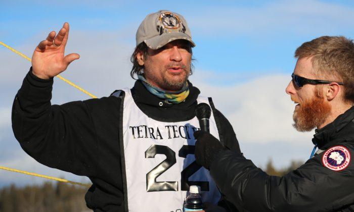 Alaskan Hugh Neff talks to media after winning the 2016 Yukon Quest in Whitehorse, Yukon, on Feb. 15, 2016. (Erik Simanis)