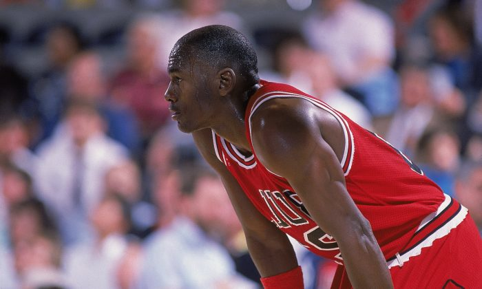 Michael Jordan (L) led the Chicago Bulls to six NBA Championships and won 10 NBA scoring titles during his illustrious NBA career. (Mike Powelll/Allsport/Getty Images)