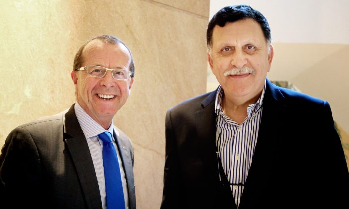 U.N. envoy for Libya Martin Kobler (L) and Fayez Serraj, Libyan designated-prime minister and head of the presidential council, in Cairo, Egypt, on Feb. 17, 2016. Kobler is urging the Libyan parliament to endorse a unity government in order to bring the country together and combat an increasingly powerful Islamic State affiliate. (AP Photo/Maggie Michael)