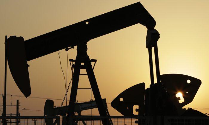 Oil pumps work in the desert oil fields of Sakhir, Bahrain, on Sept. 30, 2015. (AP Photo/Hasan Jamali)