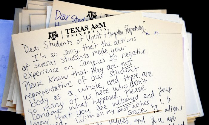 This Monday, Feb. 15, 2016, photo shows a letter addressed to visiting students from Uplift Hampton Preparatory sits atop a stack of similar notes at Texas A&M University in College Station, Texas. Texas A&M University System Chancellor John Sharp apologized Tuesday to high school students for racial insults that some minority students say they heard while visiting the College Station campus last week. (Dave McDermand/College Station Eagle via AP)