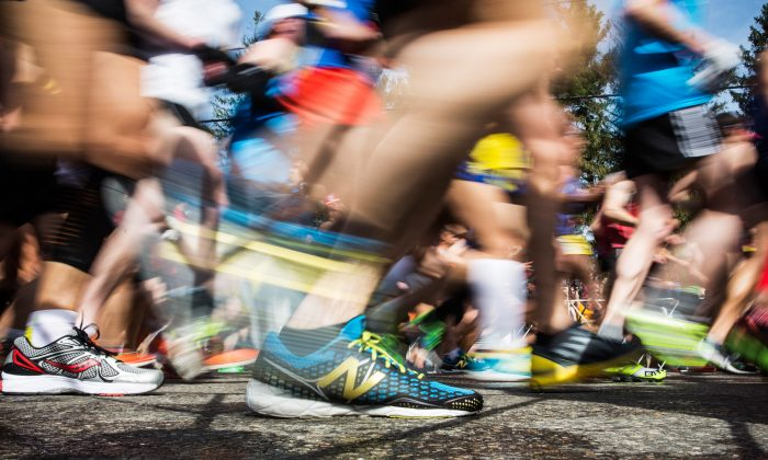 HOPKINGTON, MA - APRIL 21:  In this long exposure photograph, runner's shoes are seen at the beginning of the Boston Marathon on April 21, 2014 in Hopkington, Massachusetts. Today marks the 118th Boston Marathon; security presence has been increased this year, due to two bombs that were detonated at the finish line last year, killing three people and injuring more than 260 others.  (Photo by Andrew Burton/Getty Images)