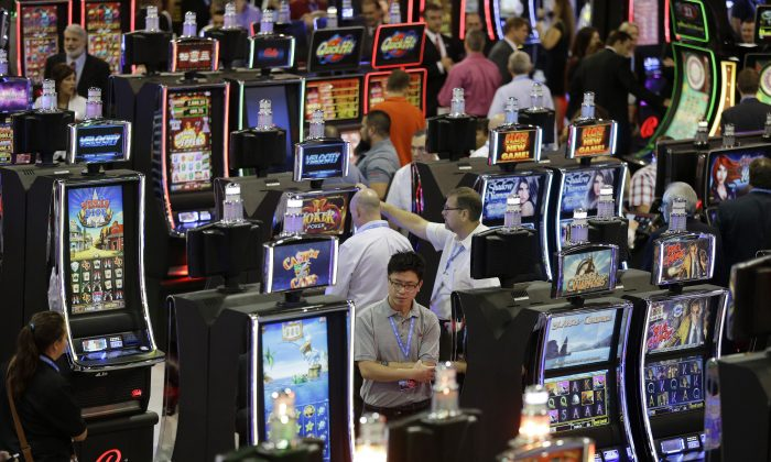 Slot machines at the Ballys Technology booth during the Global Gaming Expo in Las Vegas. (AP Photo/John Locher, File)