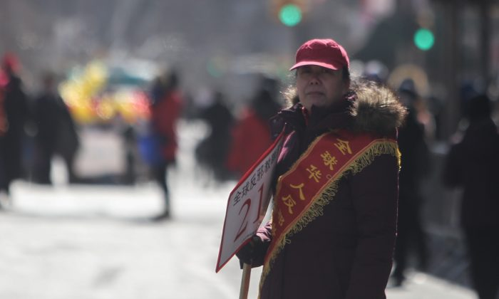 Li Huahong, head of the Chinese Anti-Cult World Alliance, a Communist Party front group that attacks Falun Gong, at the Chinese New Year's parade in Flushing, New York, on Feb. 13, 2016. (Benjamin Chasteen/Epoch Times)