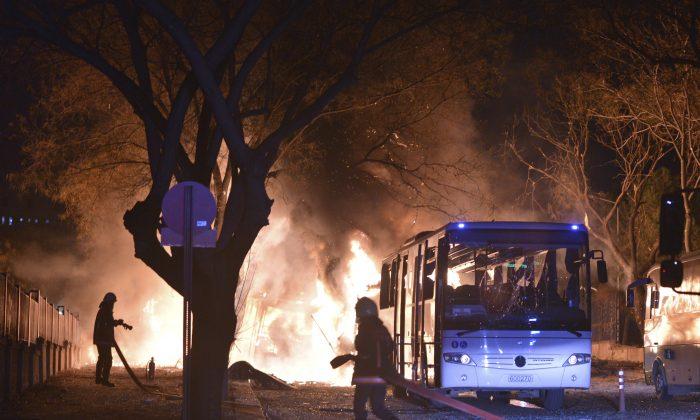 Firefighters work at a scene of fire from an explosion in Ankara, Turkey, on Feb. 17, 2016. (IHA via AP)