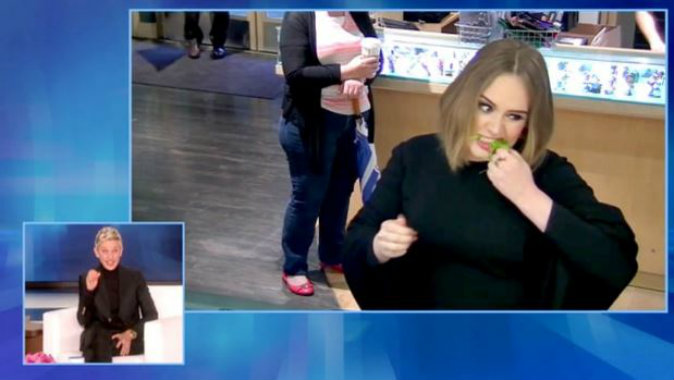 Adele, under earpiece instruction from Ellen, pranks unsuspecting Jamba Juice staff. (EllenTube)