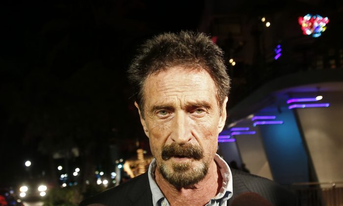 In this Wednesday, Dec 12, 2012 file photo, Anti-virus software founder John McAfee walks on Ocean Drive in the South Beach area of Miami Beach, Fla. (AP Photo/Alan Diaz, File)