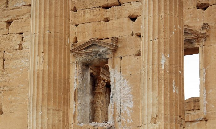 Damage during the Syria conflict caused by shelling on a wall in the ancient oasis city of Palmyra, 215 kilometres northeast of Damascus, Syria. (JOSEPH EID/AFP/Getty Images)