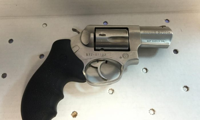 A revolver that was found in the front seat of a suspect, who crashed his car into a police vehicle, Saturday, Feb. 20, 2016 in New York. Two New York City Police officers were injured in a shootout with the suspect, Jamal Funes, early Saturday. Funes, was shot multiple times and was in critical condition at Brookdale Hospital, Police Commissioner William Bratton said. (Photo provided by NYPD)