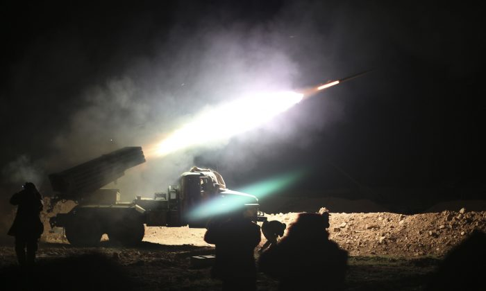 Soldiers from the Syrian army fire a rocket at Islamic State positions in the province of Raqqa, Syria, on Feb. 17, 2016. In recent weeks, Syrian government forces, with Russian air support, captured dozens of villages and towns across the country. (Alexander Kots/Komsomolskaya Pravda via AP)