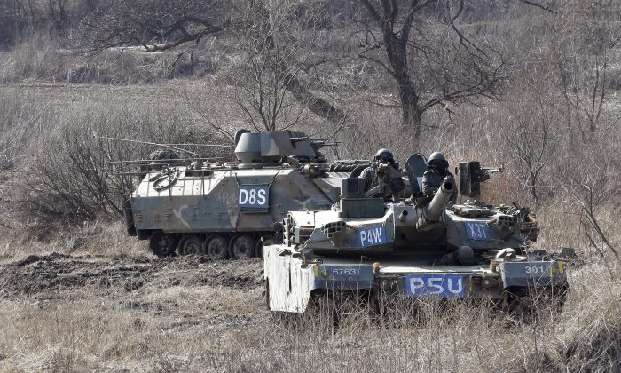 South Korean army's armored vehicles conduct an annual exercise in Paju, near the border with North Korea, on Feb. 20, 2016. (AP Photo/Ahn Young-joon)