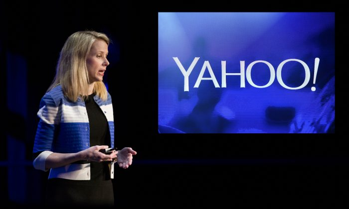 Yahoo! President and CEO Marissa Mayer at the Yahoo Mobile Developers Conference at The Masonic in San Francisco, Calif., on Feb. 18, 2016. Yahoo has recently announced a 15% reduction of its global workforce as the company continues to struggle in the rapidly-changing tech landscape. (Stephen Lam/Getty Images) Top right: A Yahoo! logo at the 2014 International CES at The Las Vegas Hotel & Casino in Las Vegas, Nev., on Jan. 7, 2014. (than Miller/Getty Images)