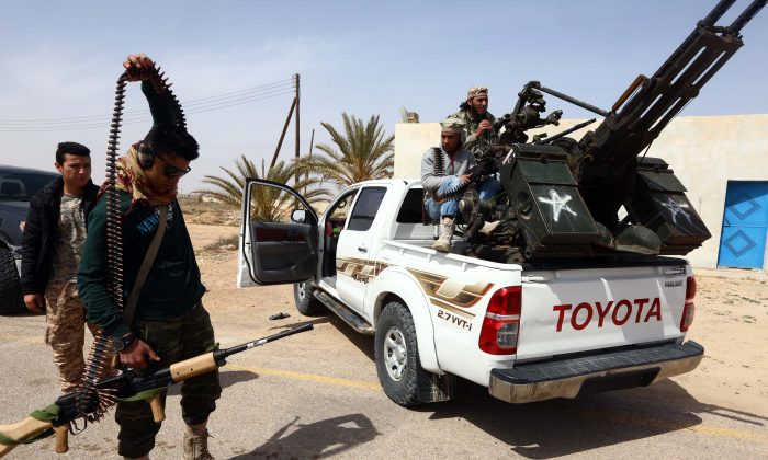 Members of forces loyal to Libya's Islamist-backed parliament General National Congress (GNC) prepare to launch attacks as they continue to fight Islamic State jihadists on the outskirts of Libya's western city of Sirte on March 16, 2015. (Mahmud Turkia MAHMUD TURKIA/AFP/Getty Images)