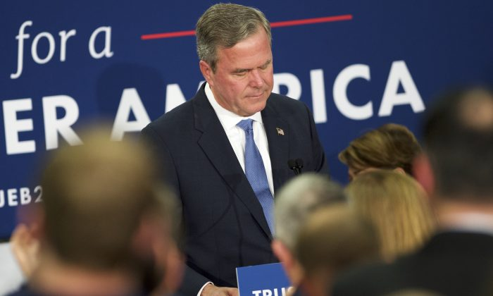 "Jeb Bush reacts as he announces the suspension of his presidential campaign during an election night party at the Hilton Columbia Center in Columbia, South Carolina, on Feb. 20. Donald Trump won decisively in the South Carolina Republican Presidential Primary, the ""first in the south."" ( Makela/Getty Images)"